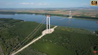 În ce stadiu au ajuns lucrările la podul suspendat de peste Dunăre. Cea mai mare lucrare de infrastructură din ultimii 30 de ani are termen de finalizare în 2023 VIDEO