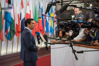 AFP: Tsipras, zdruncinat de un acord violent, dar inca nu este KO in Grecia