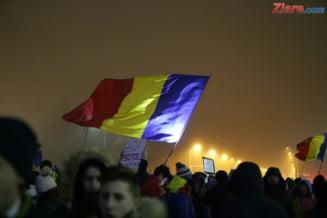 Associated Press scrie despre familiile din Romania divizate de proteste