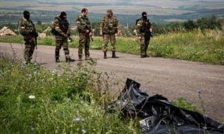 Avion doborat in Ucraina: Trupele olandeze si australiene, unda verde la locul tragediei