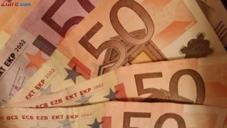 Curs valutar: Sfarsit de saptamana bun pentru leu. Euro si dolarul continua sa scada