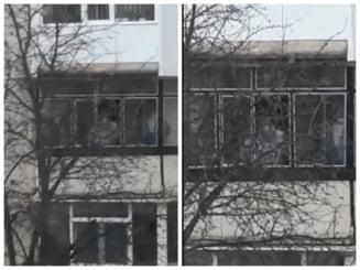 VIDEO Cum negocia atacatorul de la Onesti cu Politia, din balconul apartamentului. Un ostatic cu mainile legate la spate era langa el