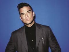 "VIDEO Robbie Williams a lansat o noua melodie, in contextul crizei COVID: ""Nimic nu va opri Craciunul. Mosul e pe sania lui, dar la doi metri distanta"""