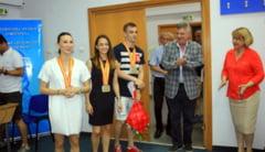 Aerobicii medaliati la Mondiale, primiti cu flori si aplauze la FEFS