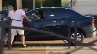 Agresorul cu BMW, care a atacat un sofer de Dacia cu crosa de golf, a fost eliberat din arest. Ce motivatie a prezentat Politia