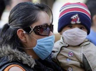 Alti doi romani au murit de gripa porcina