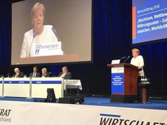 Angela Merkel nu este de acord cu termenii radicali folositi de Macron la adresa NATO