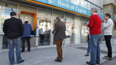 Anunt soc: Clientii Bank of Cyprus cu depozite mai mari de 100.000 de euro pierd 50% din bani