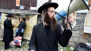 Atacuri antisemite in Ucraina: Evreii se apara singuri cu bate de baseball