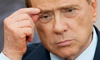 Berlusconi, invins la referendum - Opozitia ii cere demisia
