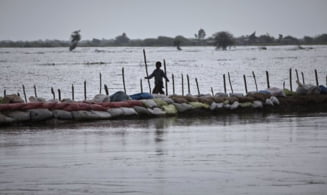 Bilantul inundatiilor din China a crescut la 90 de morti