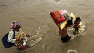 Bilantul inundatiilor din Filipine se apropie de 1.500 de morti