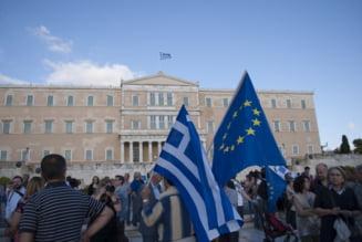 Bloomberg: Nu Grecia ar trebui sa iasa din zona euro, ci Germania