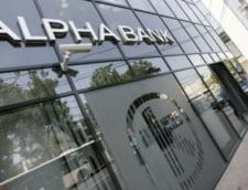 Cardurile Alpha Bank, restrictionate in strainatate - Vezi de ce