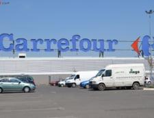 Carrefour, amendat dupa ce clientii au stat 20 de minute la coada