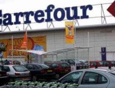 Carrefour risca amenzi de peste 200.000 de euro