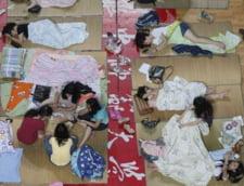 Ce fac studentii chinezi ca sa scape de canicula (Galerie foto)