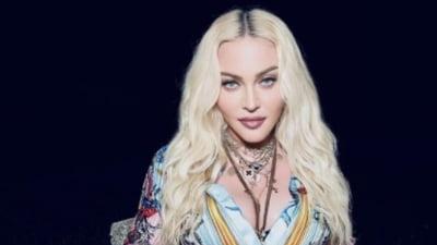 Celebra Madonna, show erotic interzis minorilor, într-o emisiune TV. Vedeta s-a întins pe masă și și-a ridicat rochia VIDEO