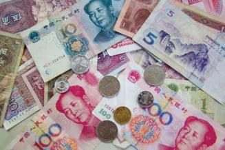China anunta ca va liberaliza gradual rata de schimb a yuanului
