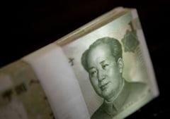 China isi liberalizeaza moneda nationala pentru a concura dominatia dolarului