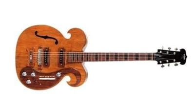 Chitara folosita de Lennon si George Harrison, vanduta la licitatie. Vezi cu cat