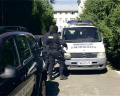 Cinci politisti acuzati ca ajutau traficantii de tigari