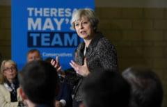Compromisul pentru putere. Theresa May face alianta cu unii care cer expulzarea catolicilor