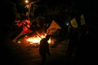 Confruntari intre palestinieni si soldati israelieni dupa anuntul SUA privind Ierusalimul. Au ars portretul lui Trump