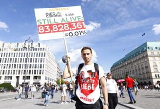 Coronavirus: Manifestatii ''anticorona'' in Germania si in Polonia