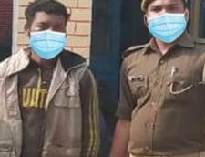 Cum a rezolvat politia indiana o fotografie in care un agent si un suspect nu purtau masti de protectie