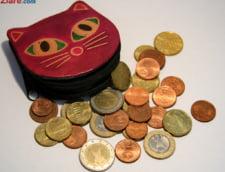 Curs valutar: Leul cedeaza teren in fata euro, dar ii tine piept dolarului