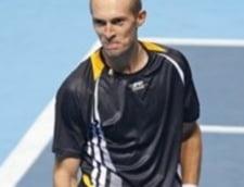 Davydenko l-a invins pe Federer si e finalist in Turneul Campionilor