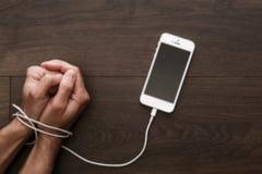 Dependenta de telefon a fost explicata, dar oamenii de stiinta nu stiu cum sa ne scape de ea