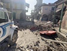 Dezastrul provocat in Haiti de cutremurul cu magnitudinea 7,2. Sute de oameni au fost prinsi sub placile de beton