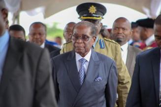 Dictatorul Mugabe si sotia sa au primit imunitate in fata legii si protectie in schimbul abdicarii