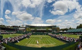 Din cauza ploii, organizatorii de la Wimbledon sunt gata sa renunte la traditii