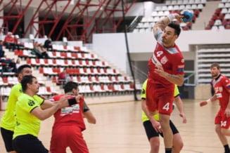 Dinamo Bucuresti a castigat un meci neobisnuit in handbal, marcand 50 de goluri