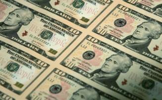 Dolarul american, din ce in ce mai contestat - Presa internationala