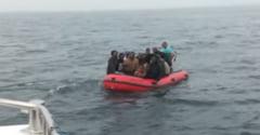 Dramele migrantilor care isi risca viata ca sa ajunga in Anglia, prin canalul Manecii. O femeie insarcinata si mai multi copii, salvati din mare