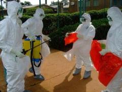 Ebola, tot mai aproape de Romania: Un britanic suspect de infectare a murit in Macedonia
