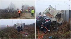 FOTO, VIDEO. Accident MORTAL la trecerea de nivel cu calea ferata la Beldiu. o persoana a DECEDAT, dupa ce un camion a fost lovit de un tren