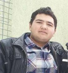 Fiul lui Omar Hayssam pune poze pe Facebook cu militanti inarmati