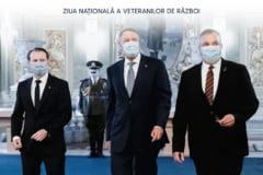 Fotografia bizara postata pe pagina de Facebook a premierului Citu. Un soldat rotofei apare cu o mustata desenata pe masca