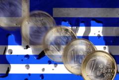 Furtuna financiara e inevitabila in Grecia, insa elenii par sa stea cu mainile in san