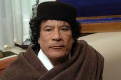 Gaddafi a fost inmormantat marti intr-un loc secret din desert