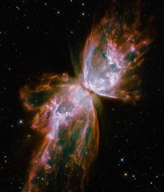 Galaxie in forma de fluture, surprinsa de Hubble (Galerie foto)