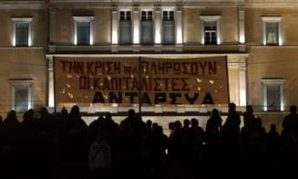 Grecia a adoptat noi masuri de austeritate (Video)