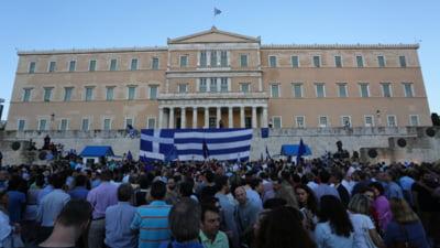 "Grecia nu va plati marti niciun euro FMI si ameninta cu justitia. Tsipras cere un ""NU"" masiv la referendum"