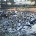Groapa de gunoi clandestina, pe un teren al Primariei Sectorului 3. Locul era acoperit cu pamant peste care se turna beton