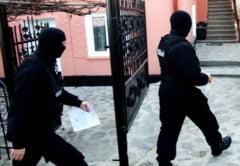 Grup infractional organizat destructurat la Cluj! Era specializat in fraude bancare!